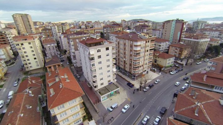 aerial-view-from-low-flying-camera-of-suburban-neighborhood-street-and-residential-blocks-residential-housing-community-in-maltepe-istanbul_re4vnlife_thumbnail-full01.jpg