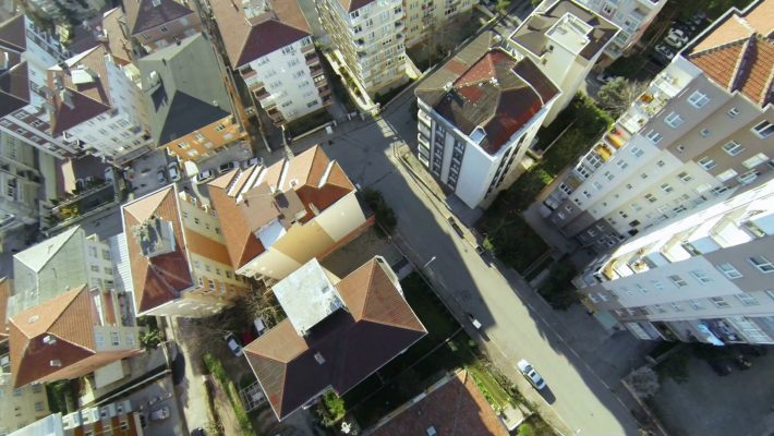 flying-over-streets-and-houses-along-suburban-architecture-in-istanbul-aerial-video-of-rooftops-from-flying-camera-top-down-city-blocks_s4f2wz_okg_thumbnail-full05.jpg